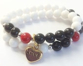 Noh8 inspired stretch bracelet with white jade, black onyx, red riverstone and gold love charm