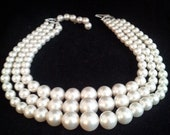 JAPAN stamped Pearl triple strand necklace