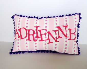 Personalized baby pillow in pink stripes and polka dots. Personalized with hot pink name.