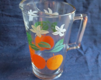 Retro Juice Pitcher with Oranges and White Lilies