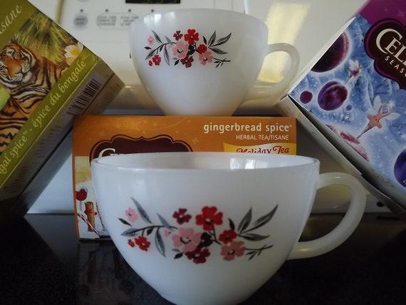 2 FireKing Milk Glass Tea Cups with Primrose Pattern