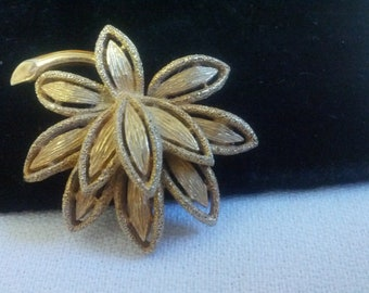 Vintage Avon  floral brooch with a brushed gold tone metal