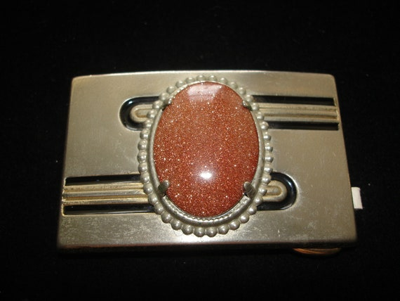 Belt Buckle with a Goldstone Cabochon