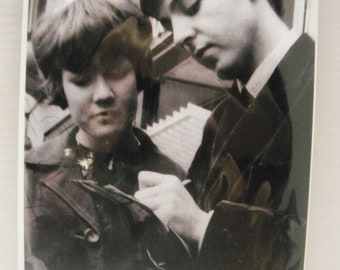 A very new Beatle,very young Paul McCartney, stopping to sign for fan, 1963, reprint