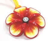 Spring flower pendant, polymer clay flower, Millefiori flower in rich warm colors: red orange and yellow, gift for girls and women