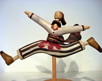Wooden running figure