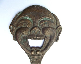 Jolly laughing man vintage cast bronze SKAL bottle opener - Collectable Kitchenalia - Possibly Scandinavian.