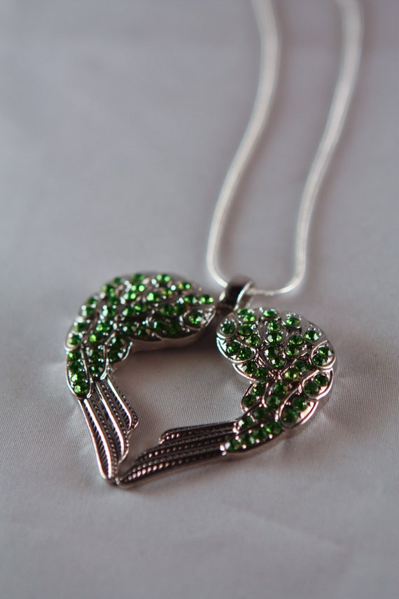 Silver-tone necklace with peridot heart shaped wings