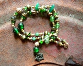 Green and light brown beaded necklace pentagram