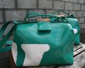 Shoulder bag made of used truck tarpaulin.