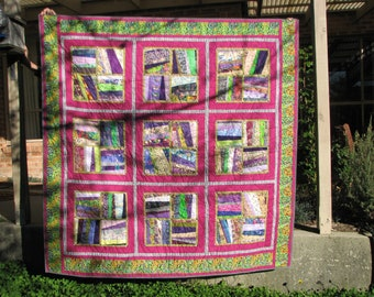 Zingy geometric quilt in bright colours
