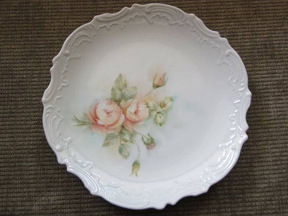Pink Roses with rose buds on a porcelain plate