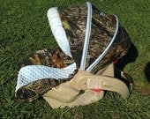mossy oak camo and baby blue carseat over