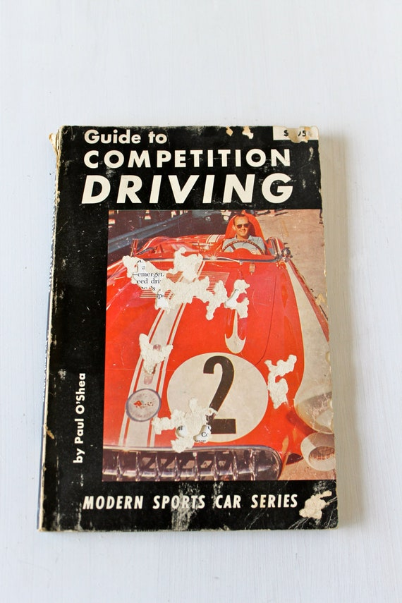 "Vintage 1957 edition of the ""Guide to Competition Driving"""