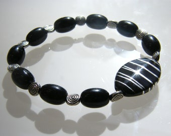 Black Onyx with silver spiral spacers and Black and Silver Focal Beaded stretch bracelet