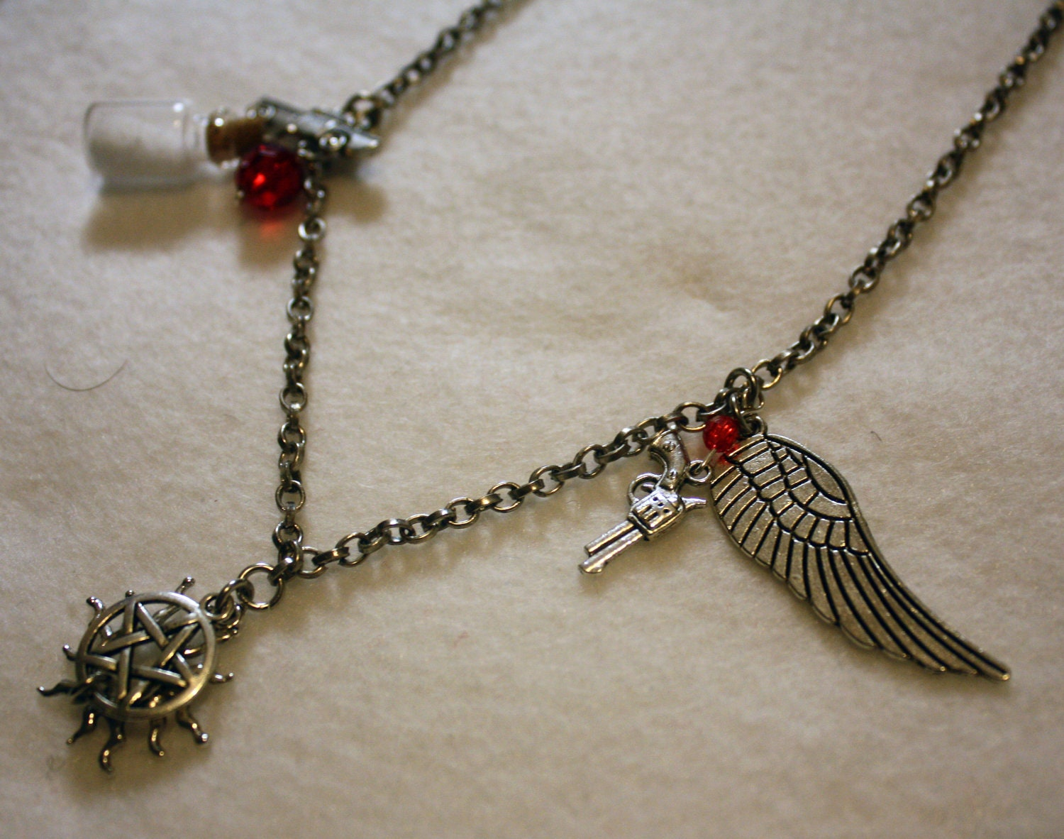 Supernatural jewelry sam and dean winchester by nerdsdoingstuff