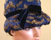 ladies vintage hat cloche style embellished with brilliant color peacock feathers