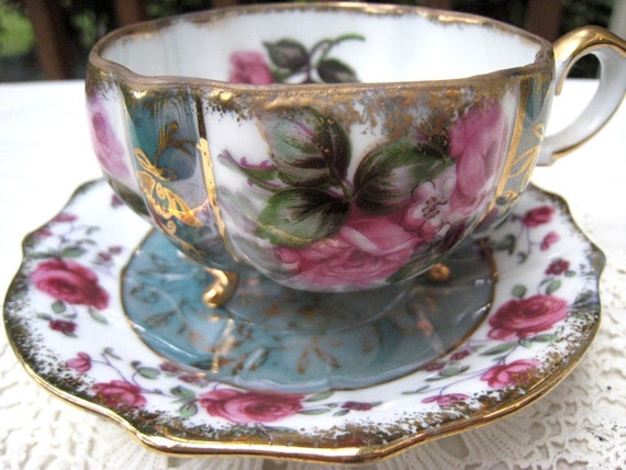 Beautiful Napco Three Footed  Cup and Saucer Floral Motif Shades of Teal, Pink and Gold