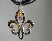 Silver and Black Tiger Striped Fleur de lis pendant necklace with purple and gold crystal accents
