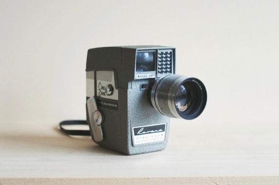 midcentury vintage movie camera. super 8 film camera. revere cine zoom model 114.