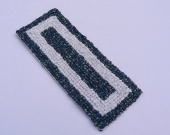"Rag T1 table trivet 5.5"" x 13"" in blues and greyish white"