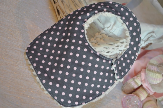 Newborn size Bib- Grey with light pink spots, backed with natural coloured chenille.