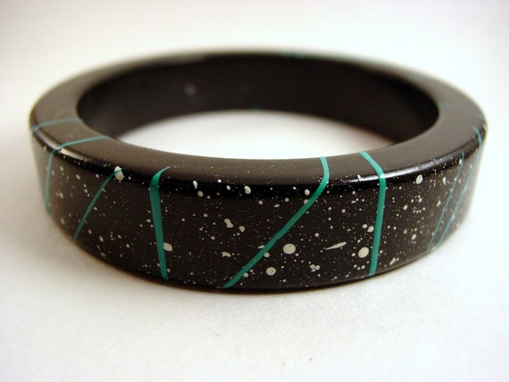 Becoming Bangled (vintage, retro black, paint-speckled plastic 80s bangle)