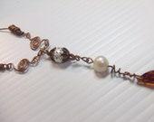 Handmade copper, pearl and swarovski necklace.