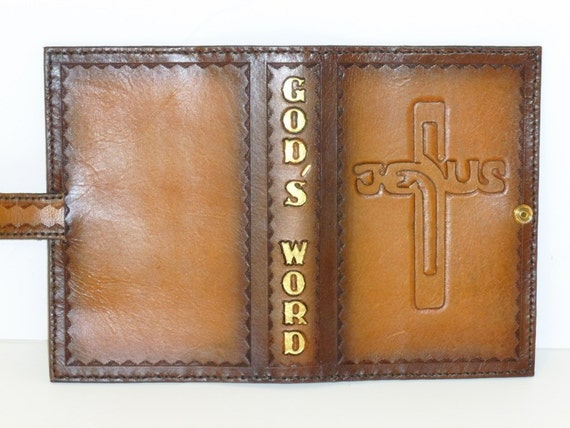 A bible cover using Jesus name shaped into a cross