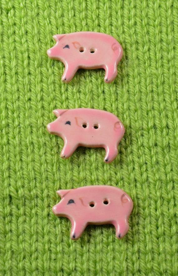 Handpainted ceramic pig buttons, x3