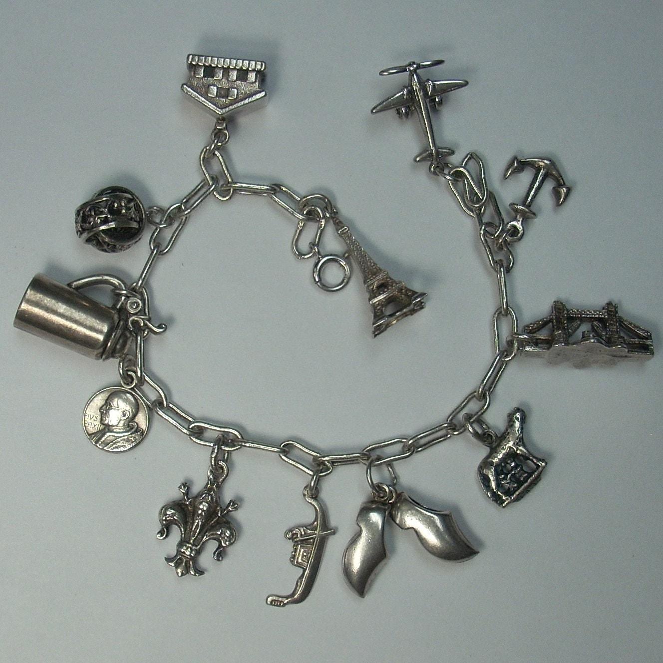 vintage sterling silver charm bracelet by gregdemarkjewelry