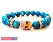 Gold Drizzled Turquoise Beaded Bracelet with Crystal Skull Charm