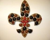 Wooden fleur de lis with glass beads