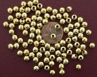 one  hundred 5mm gold plated round beads