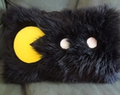 Pac-Man Pillow with Black Fur and Pac-Man Ghost Fabric