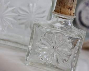 Antique and ornate glass decanter with glass stopper