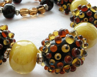 Amber color necklace with big glass lampwork beads