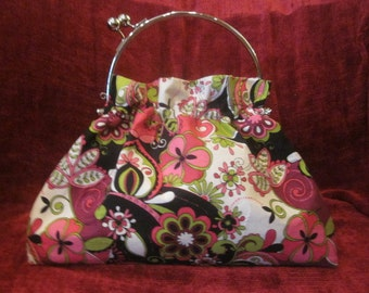 Eye-catching black, bright pink, and green floral print purse, with interchangeable handle. ITEM 021