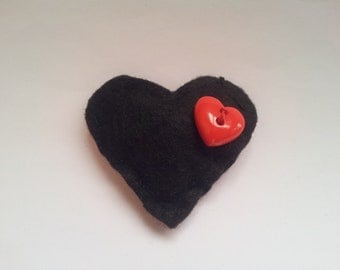 Black heart brooch with red heart button