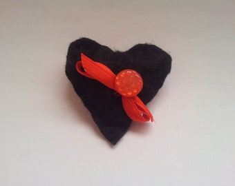 Black heart brooch with nice red button and tie