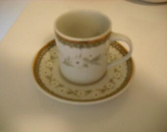 Teacup with matching saucer