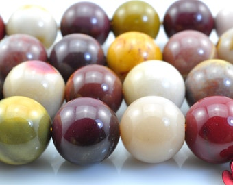 37 pcs of  Mookite smooth round beads in 10mm
