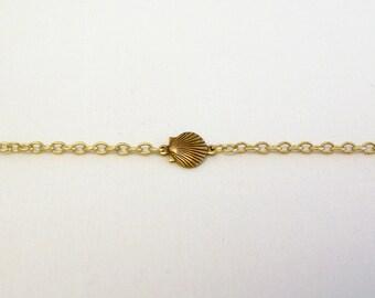 Delicate minimal nautical scallop seashell charm bracelet on delicate gold chain