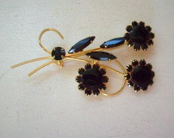 Vintage jet black flower rhinestone brooch or pin gold tone