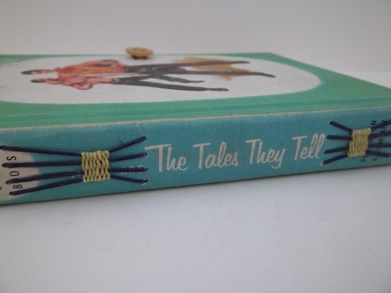 the tales they tell upcycled art journal