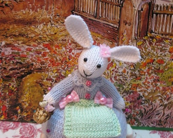 One of a kind adorable knitted decorative bunny...also can be used as a pincushion    Lots of detailwork here