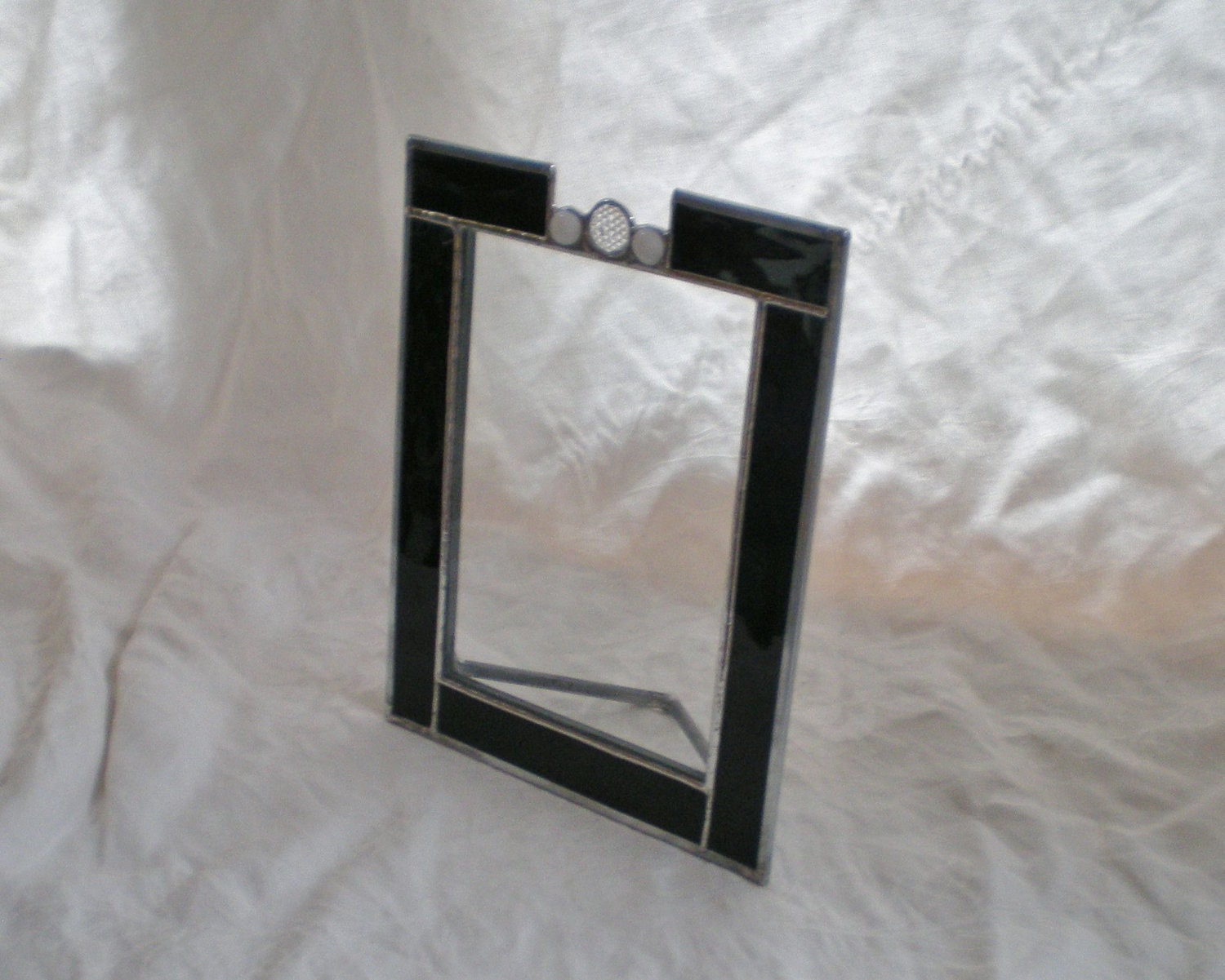 stained glass picture frame black water glass clear and white