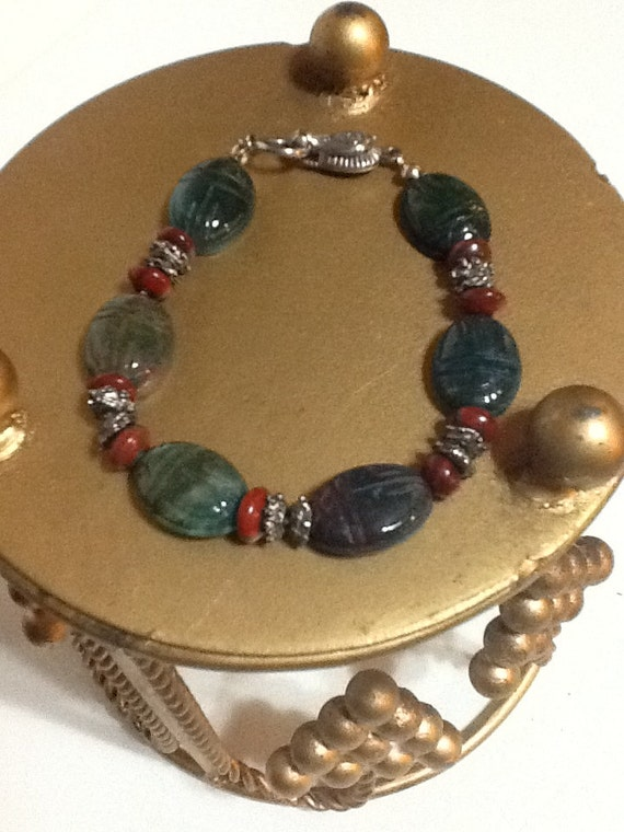 Unakite carved scarab bracelet with sterling silver clasp red jasper rondells secure fold over clasp