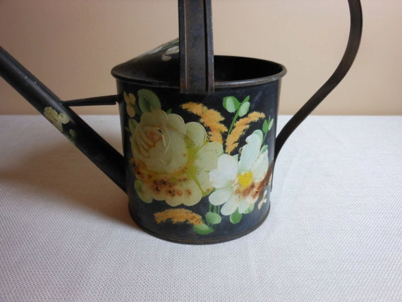 Vintage Shabby Chic Rusty Rose Watering Can with Country Charm.