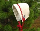 Beautiful ivory fleece baby bonnet embellished with red roses and lace for baby girls.